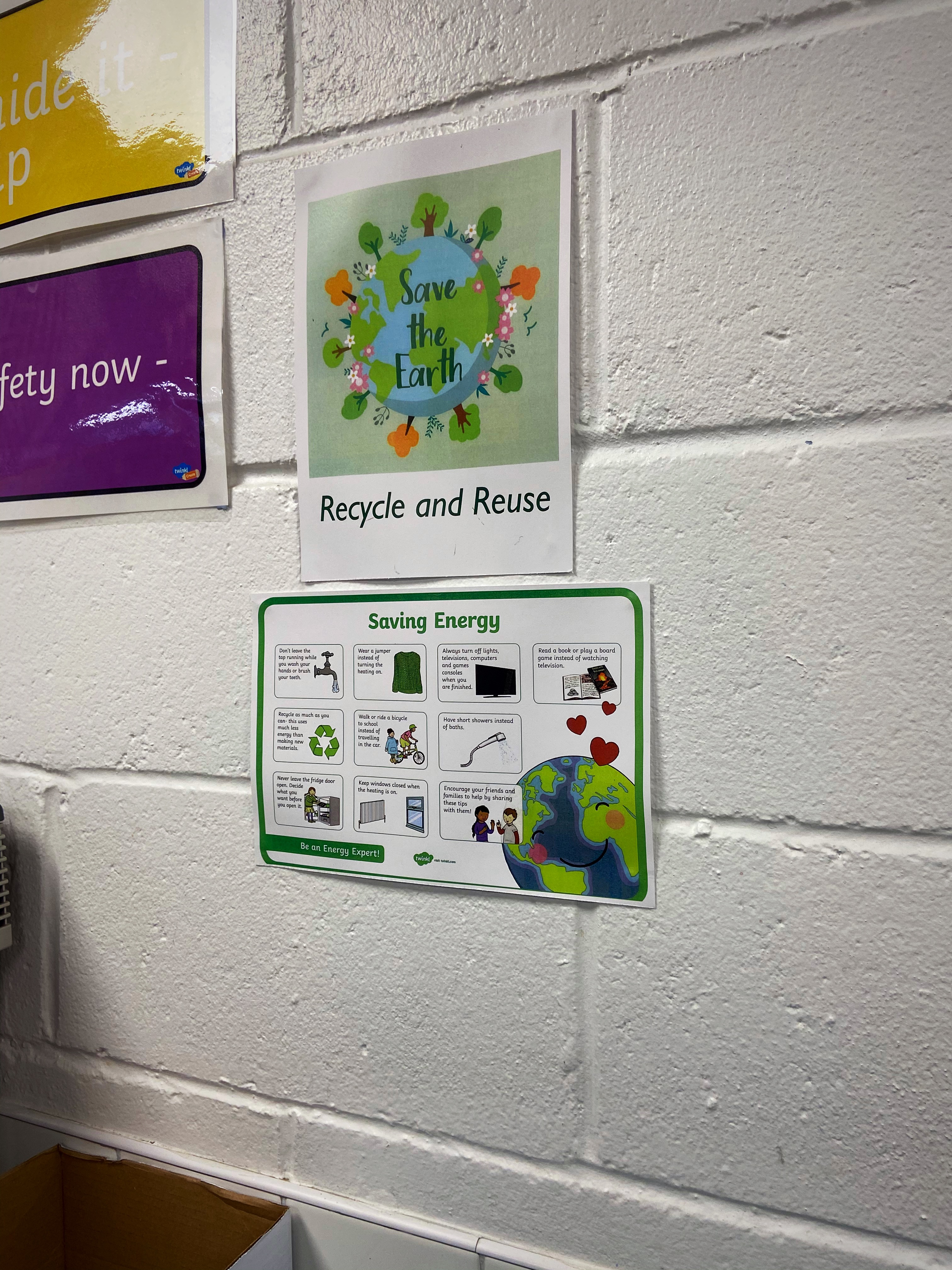 Recycling fact posters and strategies to save energy are displayed around the school